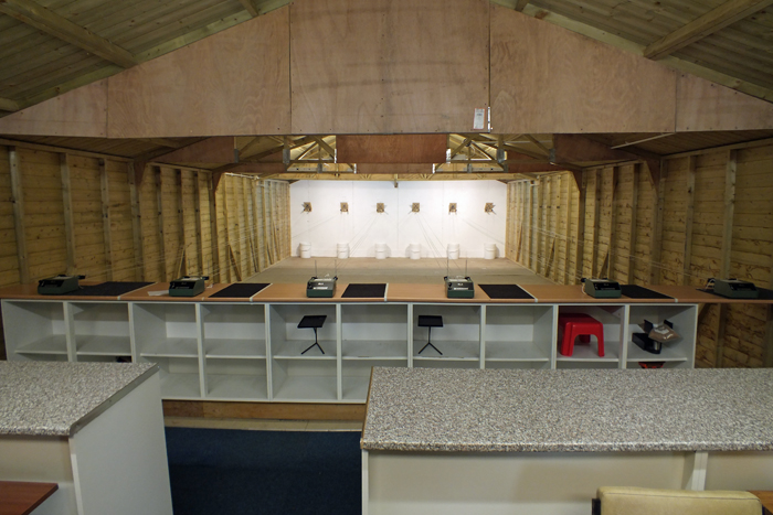 Photograph shows the Airgun Range interior - from behind the relocated firing points.