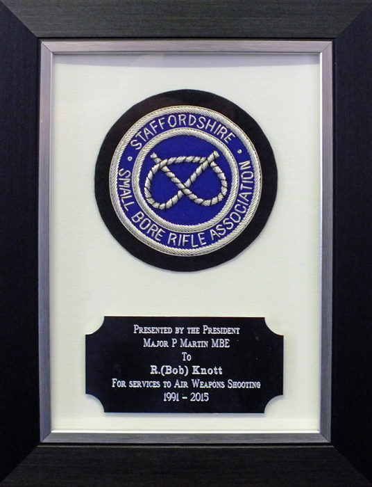 Photograph shows the 'Special Award For Services To Air Weapons Shooting' plaque presented to Robert Knott.