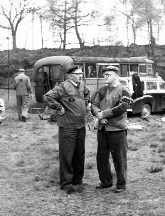 Photograph shows E.J. Chipperfield deep in conversation with a shooting colleague - it looks a serious topic too.