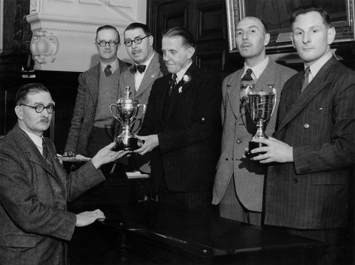 Photograph shows Edward John Chipperfield presenting various trophies.