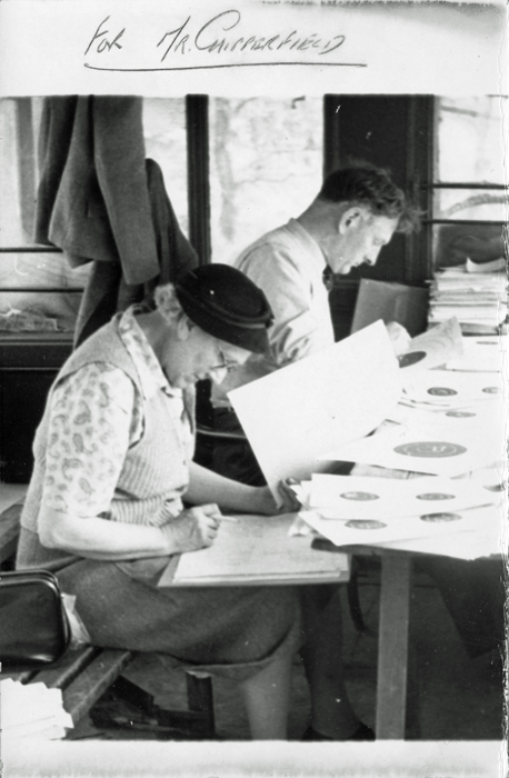 Photograph shows Mrs. Ethel Chipperfield - the wife of Edward John Chipperfield (pictured left) - scoring targets, assisted by W.B. Godwin (pictured right.)