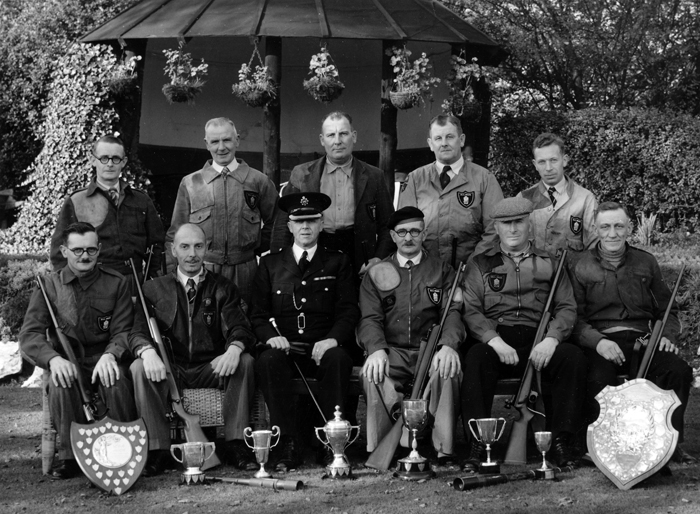 Photograph shows members of the Newcastle-under-Lyme Police Rifle Club Team, proudly displaying a plethora of trophies.  Edward John Chipperfield is pictured in the front row of the group wearing his beret.