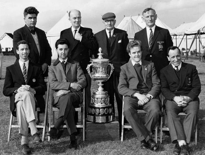 Photograph shows members of the successful Staffordshire Smallbore Rifle Team, as they proudly display the Queen Alexandra Cup.  Edward John Chipperfield is pictured in the back row wearing his flat cap.