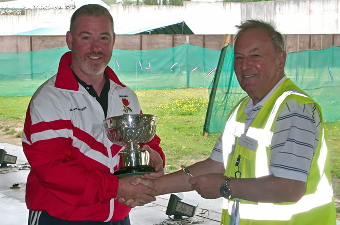 Photograph shows Martyn Buttery, pictured left, receiving The F.G. Troke Rose Bowl for 2014 from Mike Willcox.