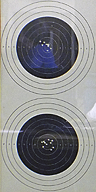 Photograph show in detail the superb accuracy of Peter's shooting on each target.