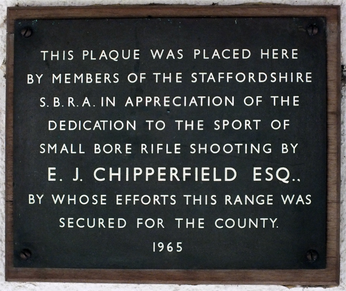 Photograph shows the plaque mounted on the clubhouse wall, dedicated to E.J. Chipperfield, to commemorate his efforts in securing the range for the county.