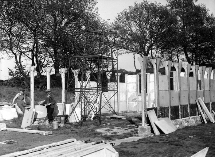 Photograph shows the new clubhouse being erected. The various sections of the clubhouse were all numbered, so that they could be assembled correctly.