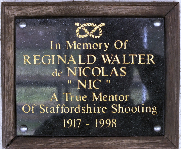 Photograph shows the plaque mounted on the clubhouse wall, dedicated to R.W. de Nicolas.