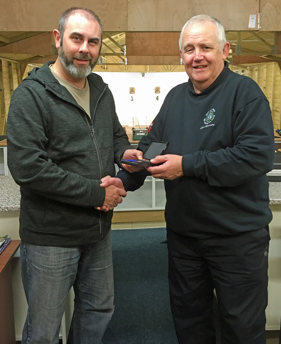 Photograph shows Scott Turner (pictured left) receiving the SSRA Individual Air Pistol League - Summer 2018 - 3rd Place Medal from Alan Whitmore (pictured right).