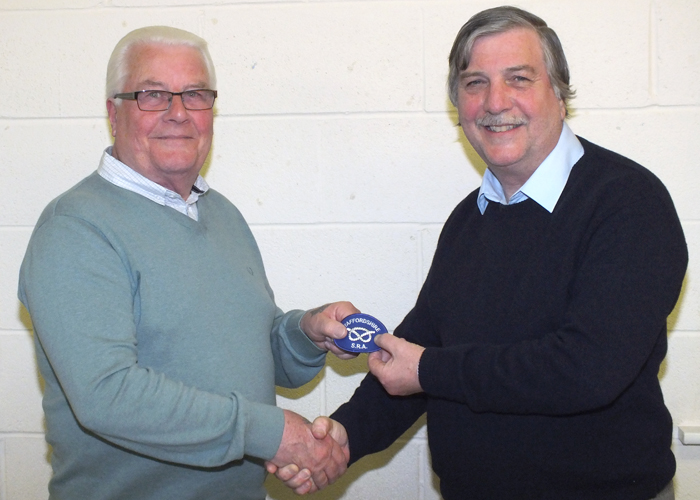 Photograph shows Bill Hulley (pictured left) receiving his Staffordshire County Badge from SSRA Airgun Secretary, Osborn Spence (pictured right).