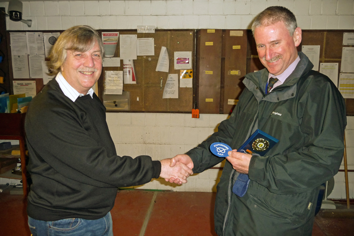 Photograph shows Martin Jupp (pictured right) receiving his Staffordshire County Badge from SSRA Airgun Secretary, Osborn Spence (pictured left).