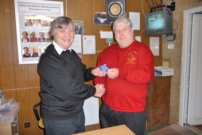 Photograph shows Paul D Barker (pictured right) receiving his Staffordshire County Badge from SSRA Airgun Secretary, Osborn Spence (pictured left).