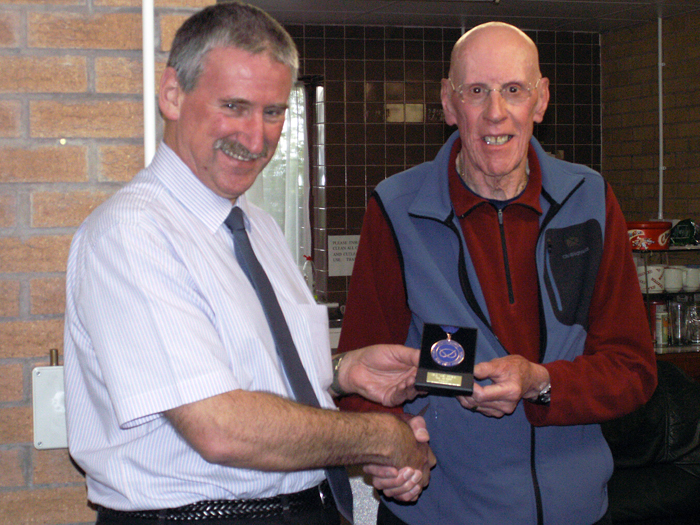 Photograph shows SSRA Vice-President - Robert Knott (pictured right), presenting Leek shooter Martin Jupp (pictured left) with his medal for finishing in 3rd place in the SSRA Air Section - Individual Air Pistol League - Winter 2014/2015 Competition.