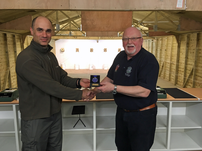 Photograph shows City of Stoke Chairman - Mike Baxter (pictured right) presenting City of Stoke shooter Theo Kyriacou (pictured left) with his SSRA Air Section - Individual Air Pistol League  - Winter 2016/2017 -Winners Medal.