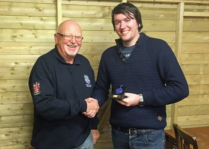 Photograph shows City of Stoke RPC Chairman - Mike Baxter (pictured left) presenting Brendon Lewin (pictured right) with his SSRA Air Pistol Individual League 1st Place Medal.