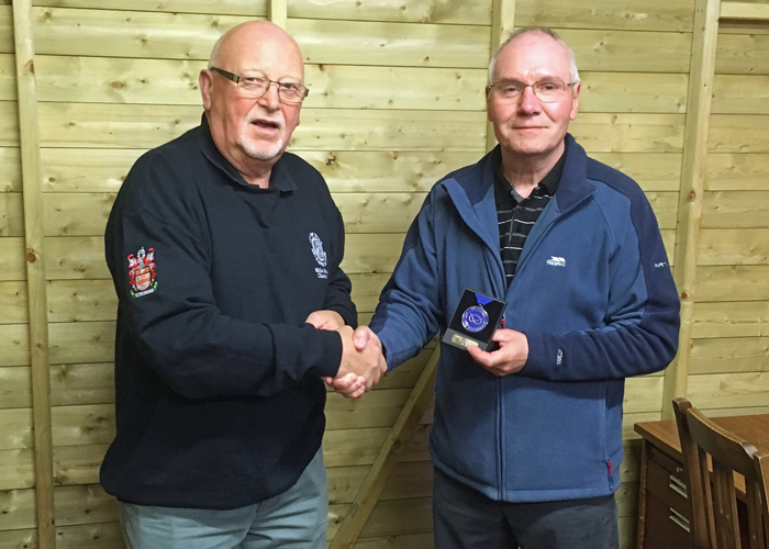 Photograph shows City of Stoke RPC Chairman - Mike Baxter (pictured left) presenting Peter Bryan (pictured right) with his SSRA Air Pistol Individual League 2nd Place Medal.
