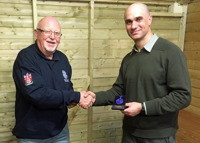 Photograph shows City of Stoke RPC Chairman - Mike Baxter (pictured left) presenting Theo Kyriacou (pictured right) with his SSRA Air Pistol Individual League 3rd Place Medal.