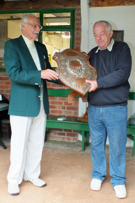 Photograph shows D. Bayley, pictured right, receiving on behalf of the City of Birmingham Rifle Club, the Association Shield from SSRA President - Major (Retired) Peter Martin, MBE.