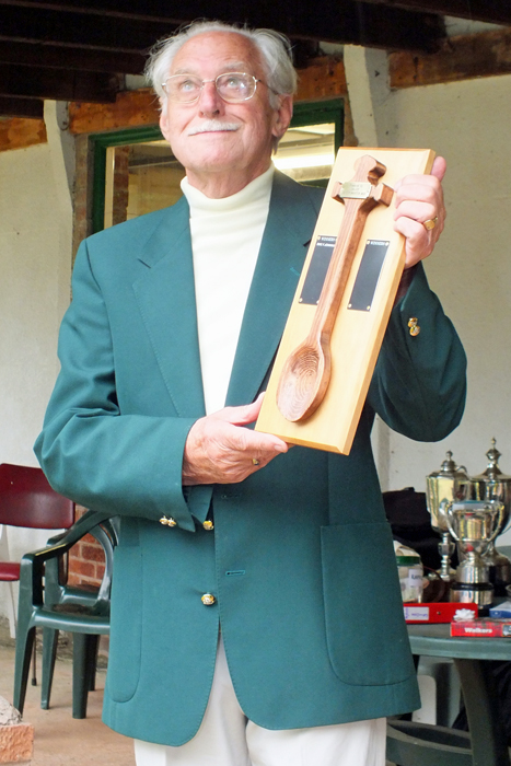 Photograph shows SSRA President - Major (Retired) Peter Martin, MBE., announcing I. Leigh as being the latest recipient of The Wooden Spoon.
