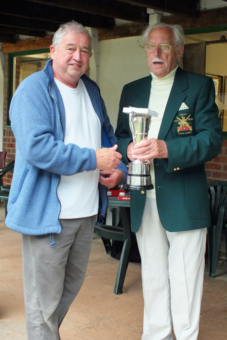 Photograph shows J. Wilshaw, pictured left, receiving the Moat Cup from SSRA President - Major (Retired) Peter Martin, MBE.