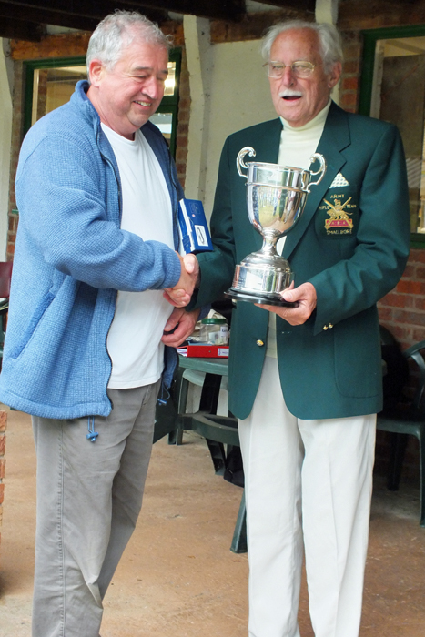 Photograph shows J. Wilshaw, pictured left, receiving The R.W. De Nicolas Memorial Trophy from SSRA President - Major (Retired) Peter Martin, MBE.