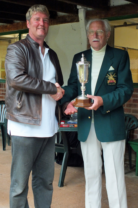 Photograph shows N. Almond, pictured left, receiving The Albert Greatrex Cup from SSRA President - Major (Retired) Peter Martin, MBE.