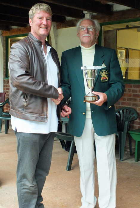 Photograph shows N. Almond, pictured left, receiving the Miniature Rifle Challenge Cup from SSRA President - Major (Retired) Peter Martin, MBE.