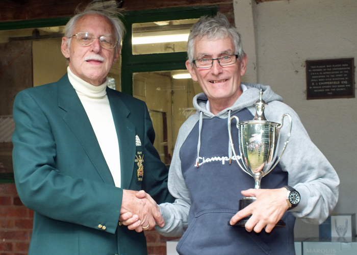 Photograph shows B. Tonks, pictured right, receiving The Michelin Cup for 2014 from SSRA President - Major (Retired) Peter Martin, MBE.