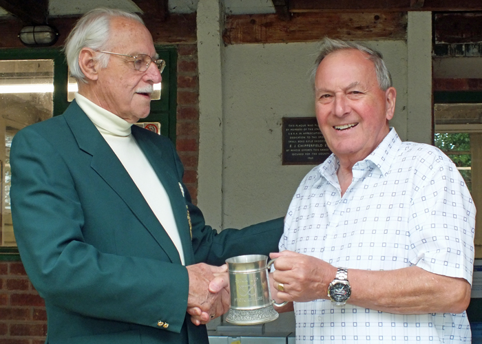 Photograph shows M. Willcox, pictured right, receiving on behalf of City of Birmingham Rifle Club, the Astor Tankard for 2014 from SSRA President - Major (Retired) Peter Martin, MBE.