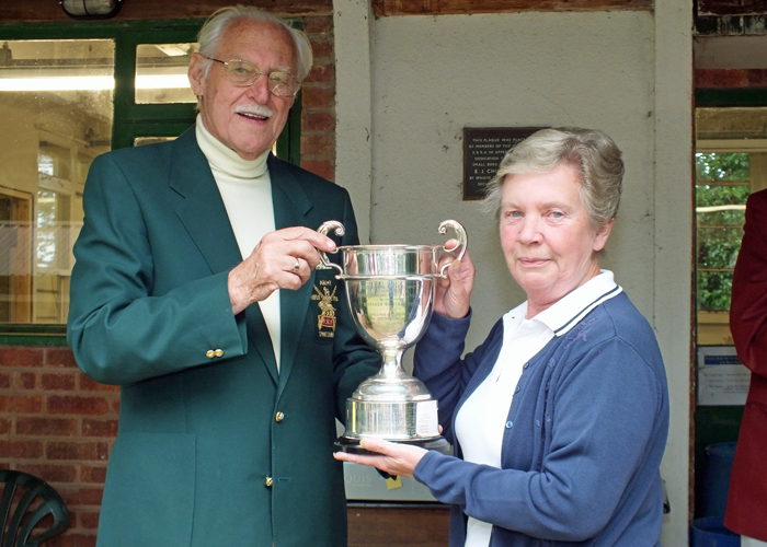 Photograph shows Mrs. M. Bayley, pictured right, receiving The R.W. De Nicolas Memorial Trophy for 2014 from SSRA President - Major (Retired) Peter Martin, MBE.