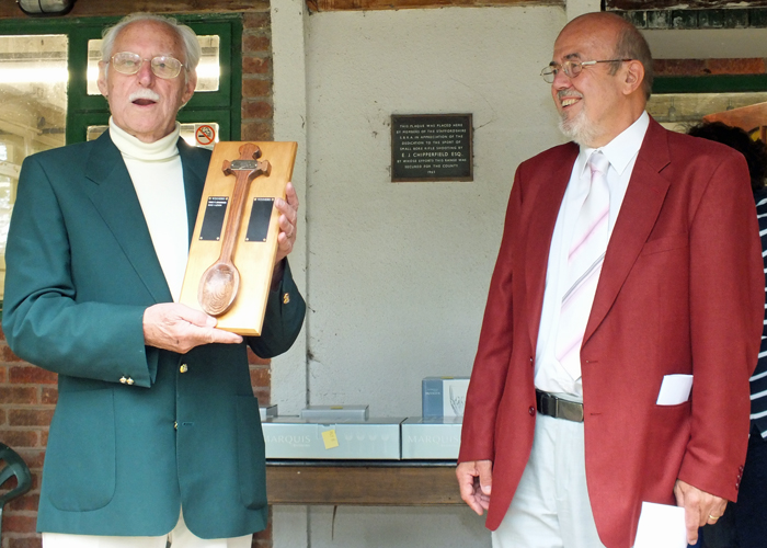Photograph shows SSRA President - Major (Retired) Peter Martin, MBE, pictured left, receiving The Wooden Spoon for 2014 from SSRA Chairman - Richard Tilstone.