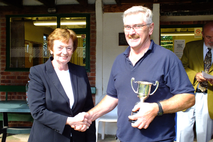 Photograph shows Mary Jennings, pictured left, presenting the Association Cup to Peter Dean, pictured right.