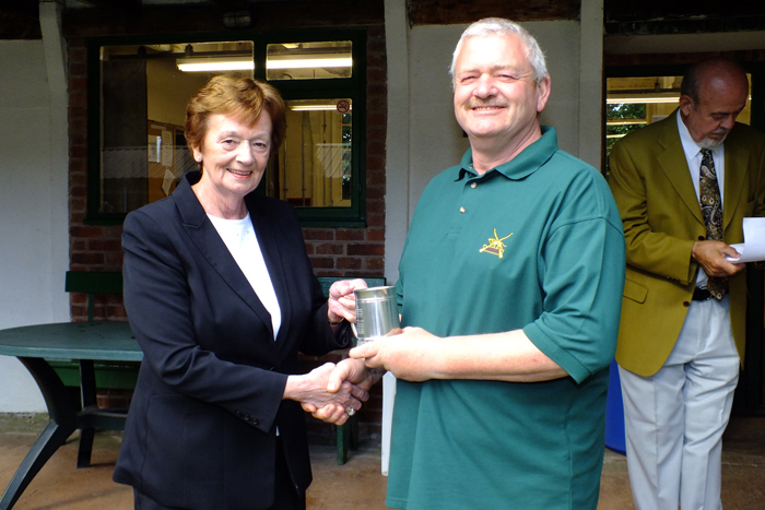 Photograph shows Mary Jennings, pictured left, presenting the Astor Tankard to Craig Howell, pictured right, who received it on behalf of Market Drayton.