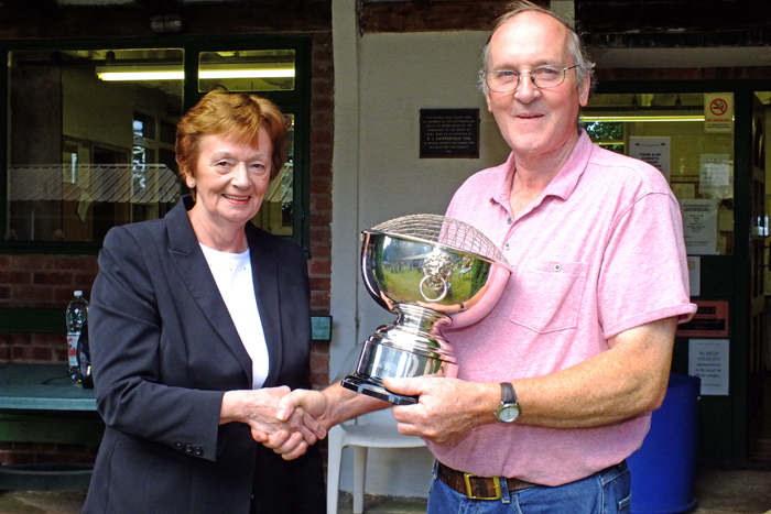 Photograph shows Mary Jennings, pictured left, presenting the K. Madeley Rose Bowl to Gordon Abbots, pictured right.