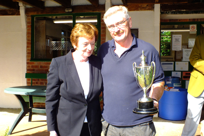 Photograph shows Mary Jennings, pictured left, presenting the Michelin Cup to Peter Dean, pictured right.