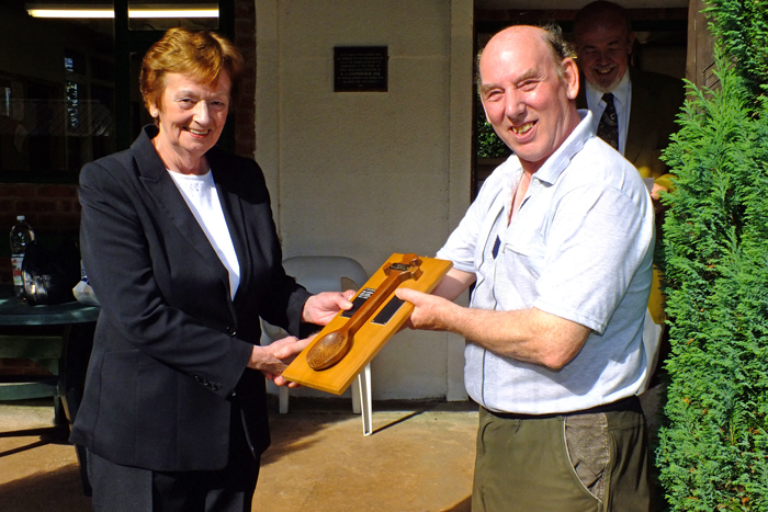 Photograph shows Mary Jennings, pictured left, presenting the Wooden Spoon to Brian Parker, pictured right.