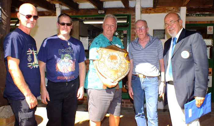 Photograph shows SSRA Chairman - Richard Tilstone (pictured right), presenting the Association Shield to members of Rugeley Rifle Club (pictured left).