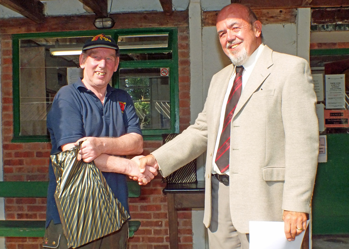 Photograph shows Brian Parker (pictured left) receiving the Class 'D' 1st Place Open Prize 2019 from SSRA Chairman - Richard Tilstone (pictured right).