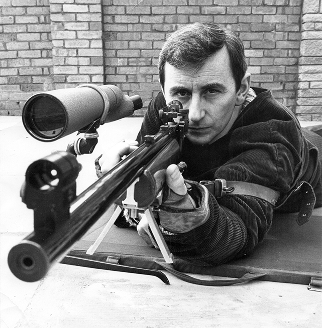 Photograph shows Fred Troke in classic prone shooting pose.