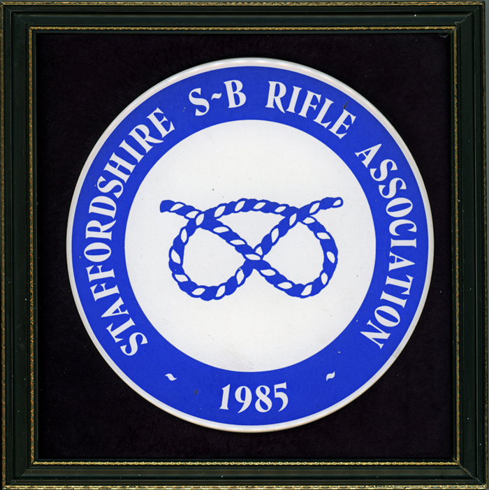 Photograph shows the ceramic plaque which was presented in 1985 by Staffordshire Smallbore Rifle Association to Major (Retired) Peter Martin, MBE.